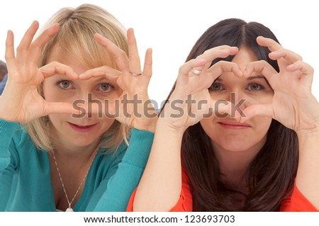 Two women making a heart with her hands / friendship - stock photo
