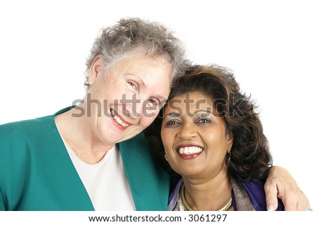 Two women of different ethnicities who are best friends.  Isolated on white. - stock photo