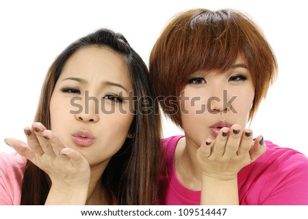 Two women posing at the camera over white background - stock photo