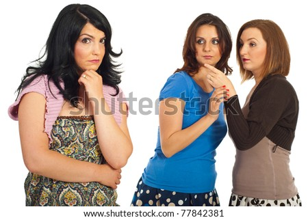 Two women tells secrets and gossip about their friend isolated on white background - stock photo