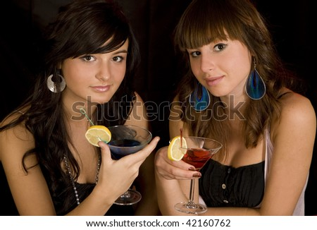 Two women with alcohol coctails - stock photo