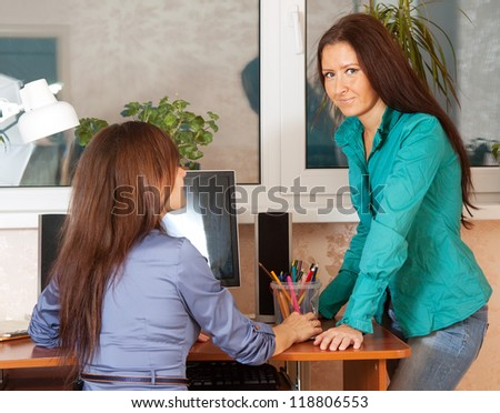 Two women works in office - stock photo