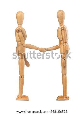 Two wooden dummies shake hands on white background - stock photo