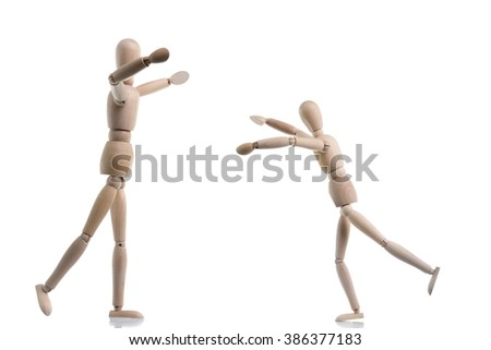 Two wooden figures are coming together to hug as a greeting, isolated on white. - stock photo