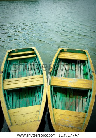 two wooden old boats berth - stock photo