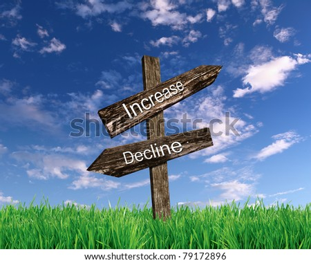 two wooden roadsigns with words increase and decline on them against blue sky - stock photo