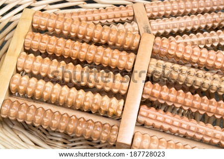Two wooden roller relief stress foot massagers - stock photo