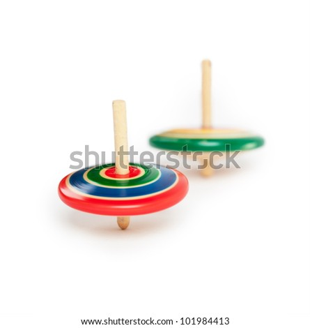 two wooden top, spinning. Isolated on white. - stock photo