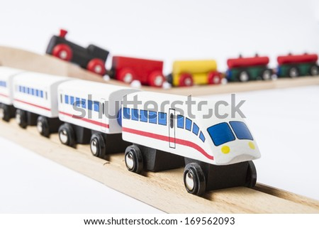 two wooden toy trains on railway isolated on white background - stock photo
