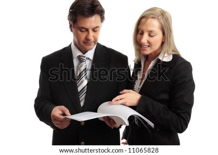 Two work colleagues discuss a report, journal, tender, etc. - stock photo