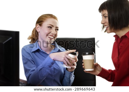 two work colleagues Having a chat and gossip at work over a coffee - stock photo