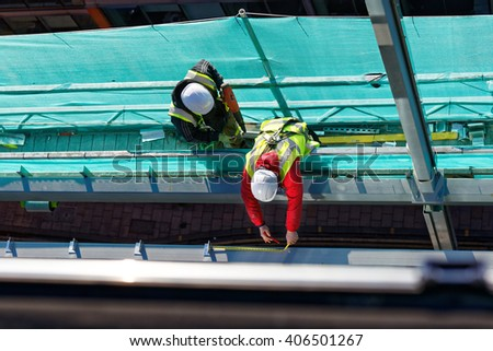 two workers on construction site - stock photo