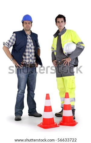 Two workers on white background - stock photo