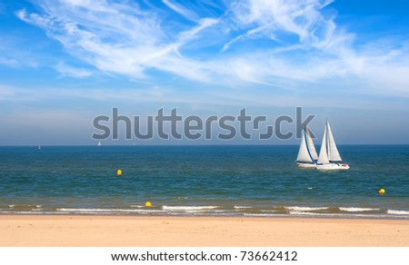 Two yachts racing near seashore in the Pas-de-Calais, France - stock photo