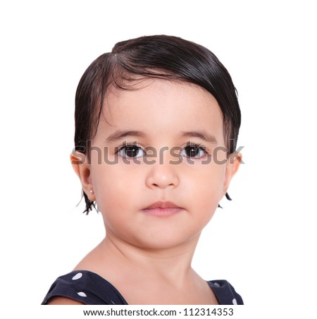 two year old girl looking seriously at the camera - stock photo