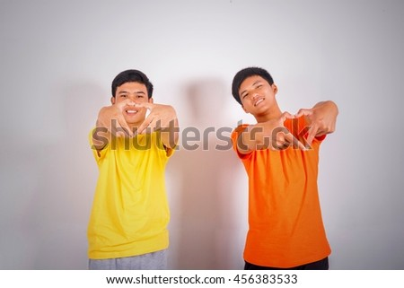 Two young asian man make heart symbol by their hands - stock photo