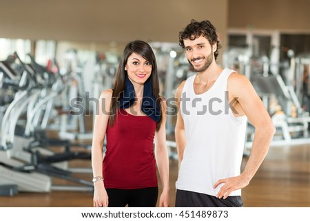 Two young athletes in a gym - stock photo