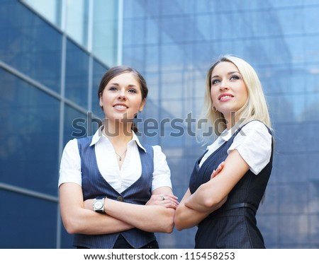 Two young attractive business women - stock photo