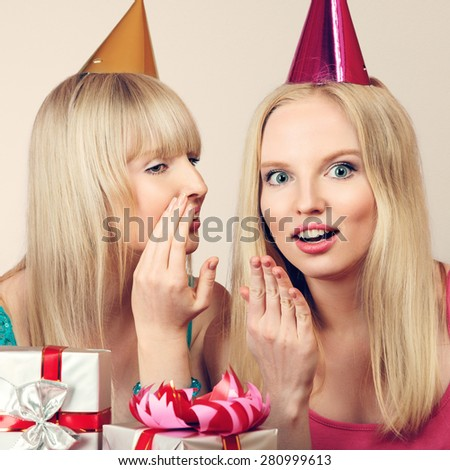 Two young beautiful blonde women celebrating birthday - stock photo