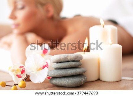 Two young beautiful women relaxing and enjoying at the spa center - stock photo