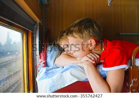 Two young blond boy in a train - stock photo