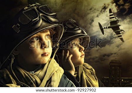 Two young boy soldiers looking at the skies - stock photo