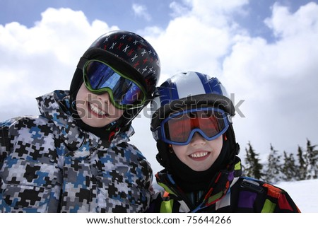 two young boys in skiing outfit - stock photo