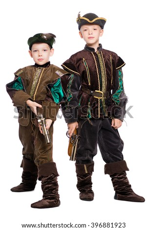 Two young boys posing in suits of medieval hunters. Isolated on white - stock photo