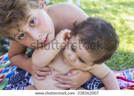 two young brothers playing together - stock photo
