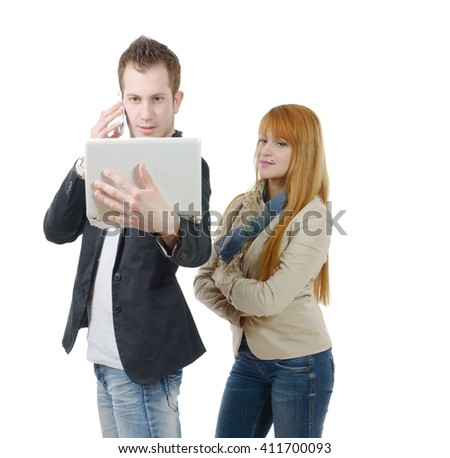 two young business people working together with a laptop and phone, on white - stock photo