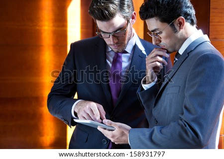 Two young Businessmen With Digital Tablet  In Modern Office - stock photo
