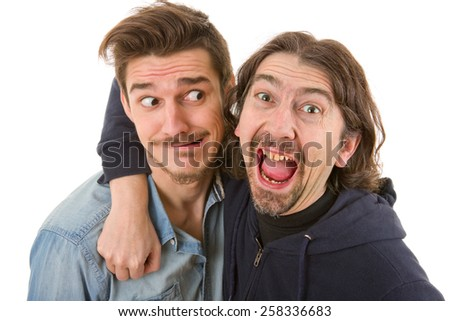 two young casual silly men, isolated on white - stock photo