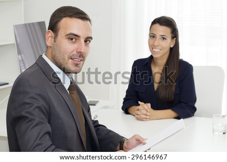 Two young colleagues together working.  - stock photo