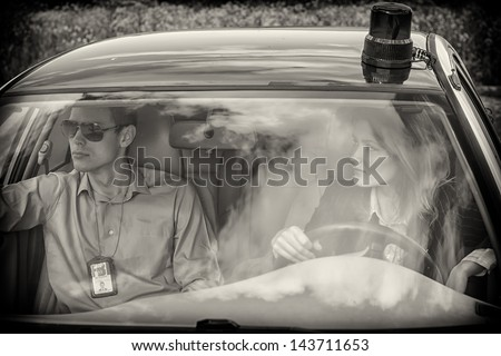 Two young detectives driving to crime scene. Black and white - stock photo