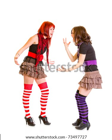 Two young emotional girlfriends quarrel isolated on white - stock photo