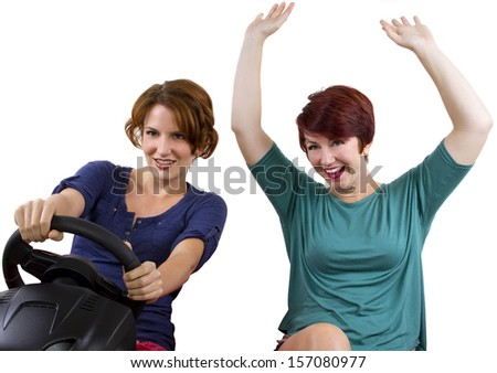two young female driving on a road trip with white background - stock photo