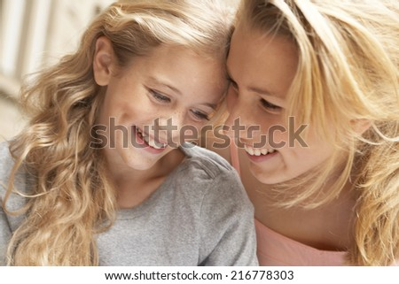 Two young females laughing. - stock photo