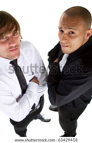 Two young funny businessmen over isolated white background acting goofey. - stock photo
