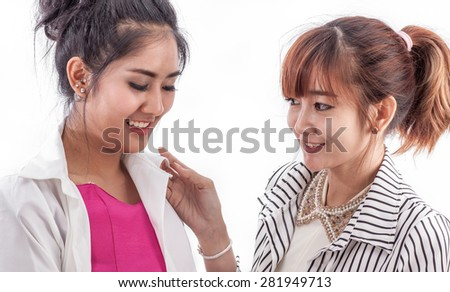 Two young girl change and choose fashion cloth - stock photo