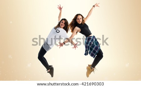 Two young girl dancing street dance - stock photo