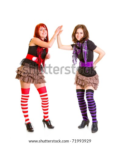 Two young girlfriends clapping hands isolated on white - stock photo