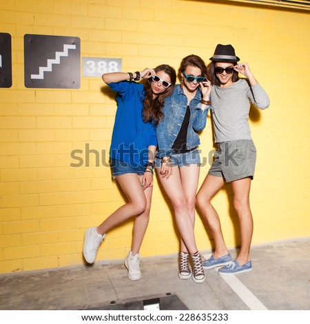 Two young girls and guy having fun. Lifestyle - stock photo