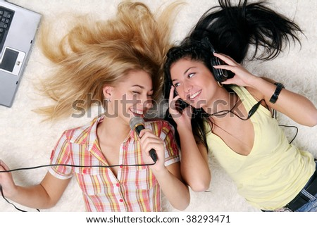 two young girls at home - stock photo