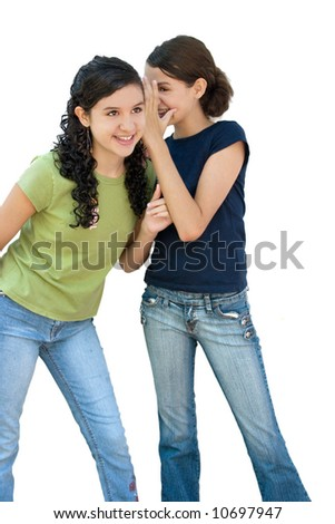 two young girls laughing behind another girls back - stock photo