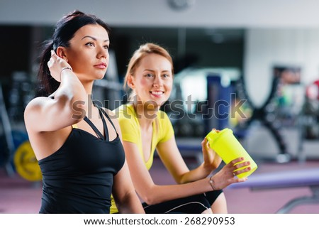 Two young girls resting after training - stock photo