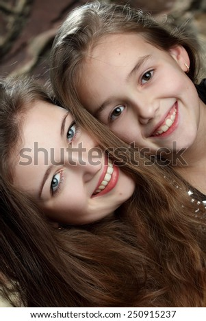 two young girls, sisters. sincere emotions. active. beautiful smile - stock photo