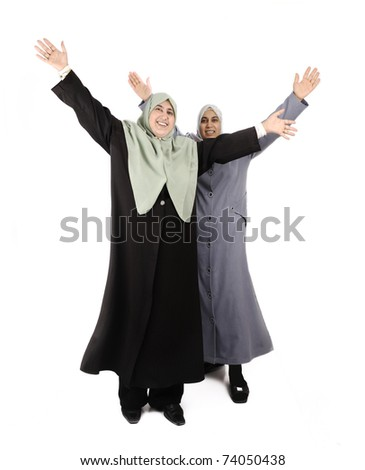 two young happy muslim women isolated - stock photo