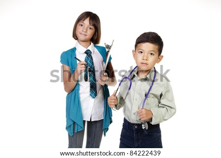 Two young kids in a concept image of future careers. - stock photo
