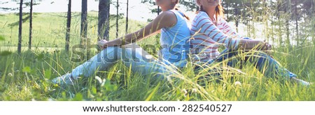 Two young ladies walking at the forest - stock photo