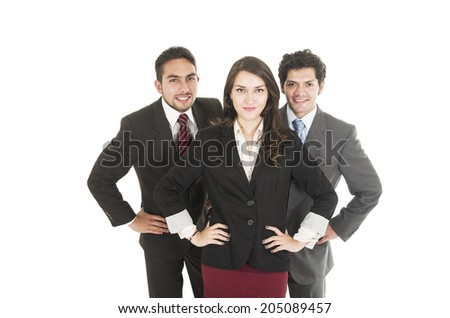 two young men and a beautiful girl dressed in suits with hands on hips  - stock photo